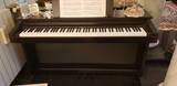 vendesi-pianoforte-digitale-usato-con-tastiera-pesata